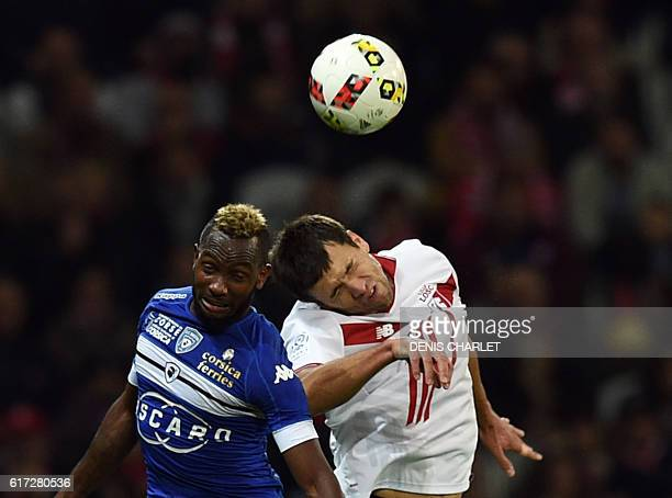 Lille's Argentinian defender Renato Civelli vies with Bastia's French midfielder Lenny Nangis during the French L1 football match between Lille OSC...