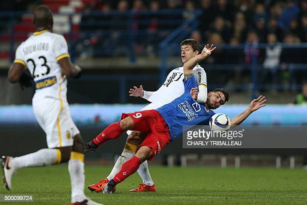 Lille's Argentinian defender Renato Civelli vies with Caen's French forward Andy Delort during the French L1 football match between Caen and Lille on...