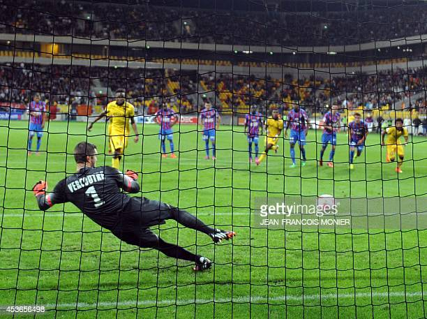 Lille's Belgian forward Divock Origi scores against Caen's French goalkeeper Remy Vercoutre during the French L1 football match between Caen and...