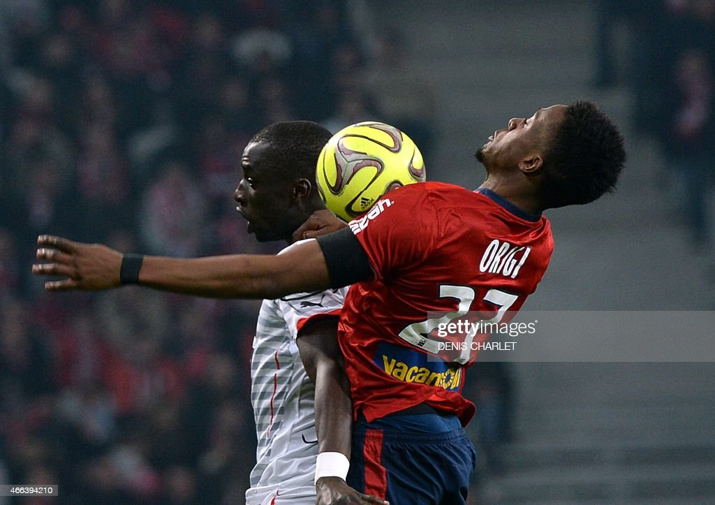 Lille's Belgian forward <a gi-track='captionPersonalityLinkClicked' href=/galleries/search?phrase=Divock+Origi&family=editorial&specificpeople=10183754 ng-click='$event.stopPropagation()'>Divock Origi</a> (R) vies for the ball with Rennes' French midfielder Fallou Diagne during the French L1 football match between Lille (LOSC) and Rennes (SRFC) on March 15, 2015 at the Pierre Mauroy stadium in Villeneuve-d'Ascq, northern France.