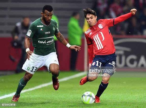 Lille's Brazilian forward Luiz Araujo vies with SaintEtienne's Ivorian midfielder Habib Maiga during the French L1 football match between Lille and...