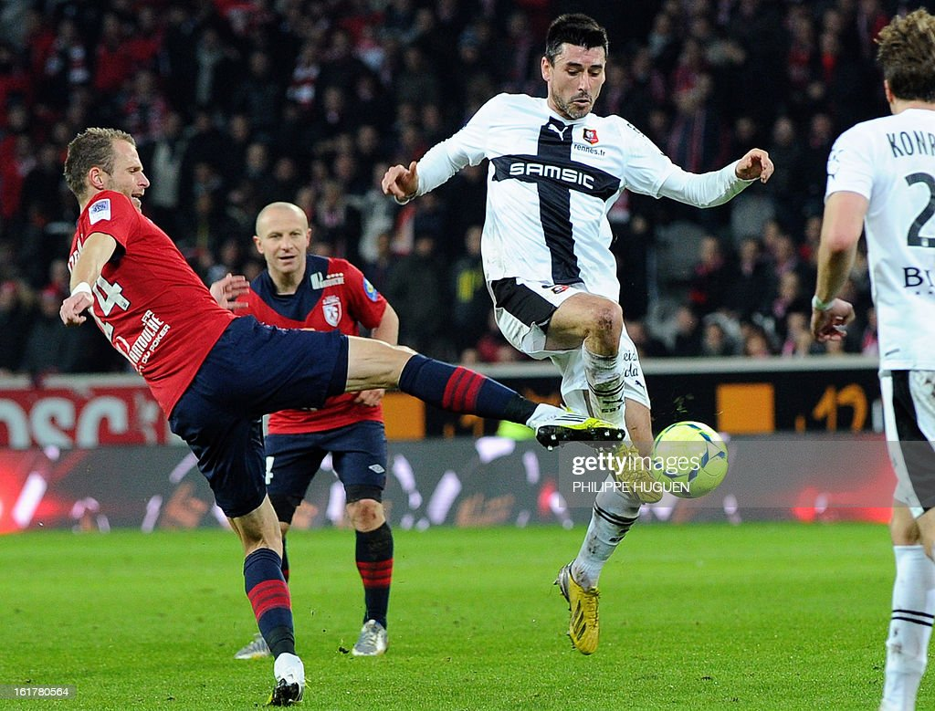 Lille's Czech defender David Rozehnal (L) vies with Rennes' French midfielder Julien Feret during the French L1 football match Lille vs Rennes, on February 15, 2013 at the Grand Stade Stadium in Villeneuve d'Ascq.