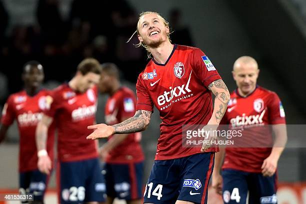 Lille's Danish defender Simon Kjaer celebrates after scoring his team's second goal during the French League Cup football match Lille vs Nantes on...
