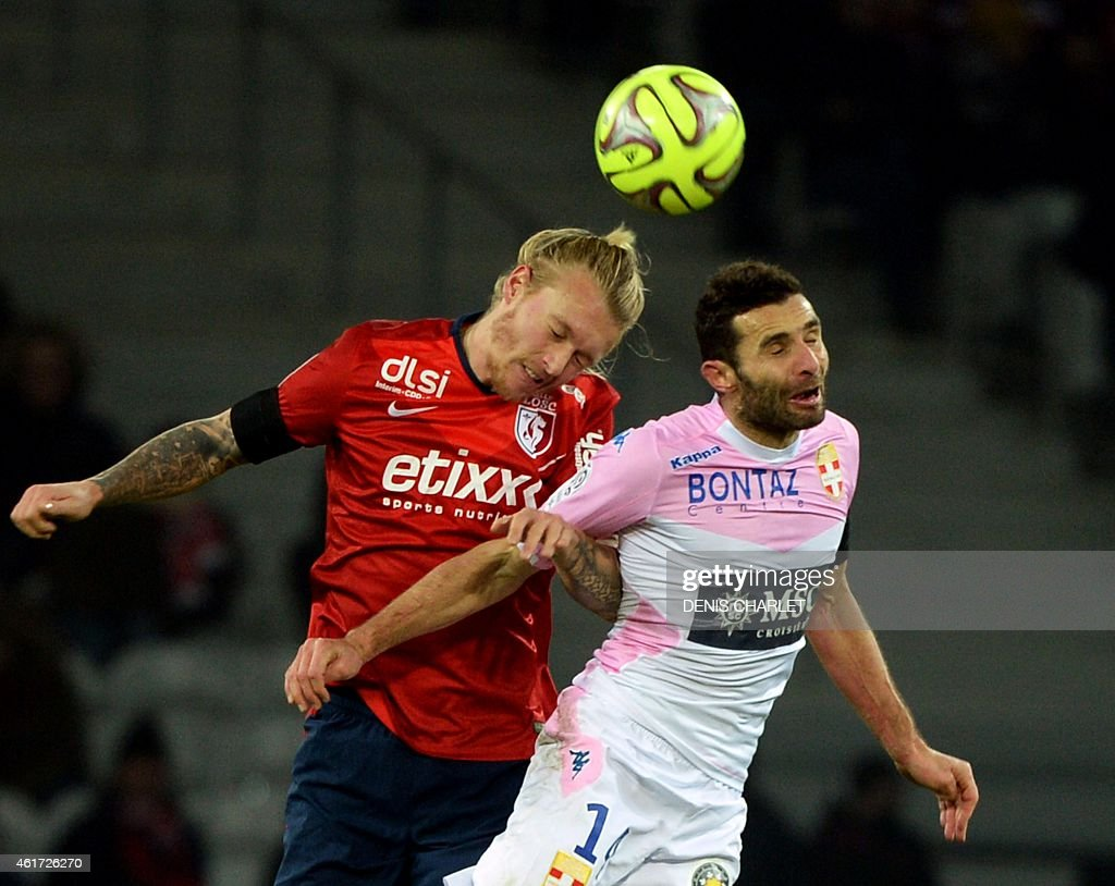 Lille's Danish defender <a gi-track='captionPersonalityLinkClicked' href=/galleries/search?phrase=Simon+Kjaer&family=editorial&specificpeople=4895333 ng-click='$event.stopPropagation()'>Simon Kjaer</a> (L) jumps for the ball with Evian's French midfielder Cedric Barbosa during the French L1 football match between Lille (LOSC) and Evian (ETGFC) on January 7, 2015 at the Pierre-Mauroy stadium in Villeneuve-d'Ascq, northern France. AFP PHOTO / DENIS CHARLET