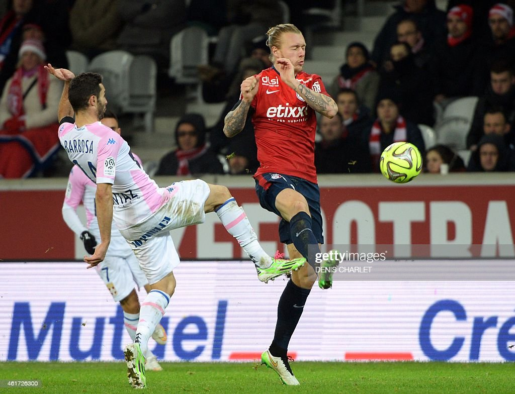 Lille's Danish defender <a gi-track='captionPersonalityLinkClicked' href=/galleries/search?phrase=Simon+Kjaer&family=editorial&specificpeople=4895333 ng-click='$event.stopPropagation()'>Simon Kjaer</a> (R) vies with Evian's French midfielder Cedric Barbosa during the French L1 football match between Lille (LOSC) and Evian (ETGFC) on January 7, 2015 at the Pierre-Mauroy stadium in Villeneuve-d'Ascq, northern France. AFP PHOTO / DENIS CHARLET