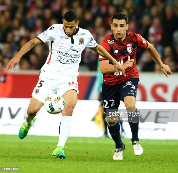 Lille's defender Junior Alonso vies with Nice's FrenchMoroccan midfielder Younes Belhanda during the French L1 football match between Lille and Nice...