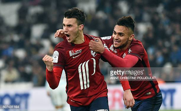 Lille's defender Sebastien Corchia celebrates with a teammate after scoring a goal during the French L1 football match between Marseille and Lille at...