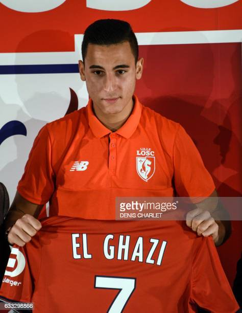 Lille's Dutch new player Anwar El Ghazi poses with his jersey during a press conference for the presentation of three new players on February 1 2017...