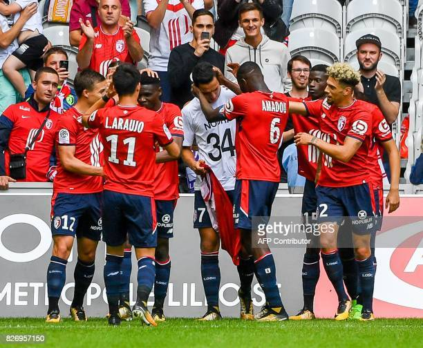 Lille's DutchMorrocan forward Anwar ElGhazi celebrates with teammates after scoring a goal during the French Ligue 1 football match between Lille and...
