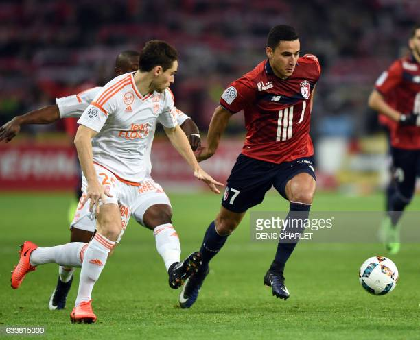 Lille's forward Anwar El Ghazi vies with Lorient's French defender Vincent Le Goff during the French Ligue 1 football match between Lille OSC and...