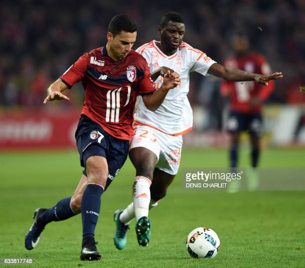 Lille's forward Anwar El Ghazi vies with Lorient's Ivorian forward Moryke Fofana during the French Ligue 1 football match between Lille OSC and...
