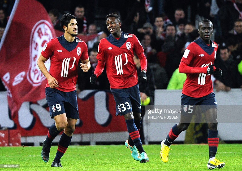Lille's forward Divock Origi (C) celebrates after scoring a goal during the French L1 football match Lille vs Troyes on February 2, 2013 at the Grand Stade Stadium in Villeneuve d'Ascq.