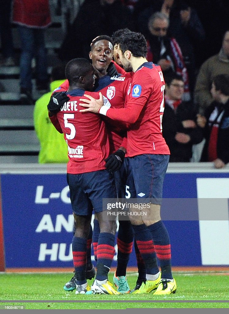 Lille's forward Divock Origi (C) celebrates with teammates after scoring a goal during the French L1 football match Lille vs Troyes on February 2, 2013 at the Grand Stade Stadium in Villeneuve d'Ascq.