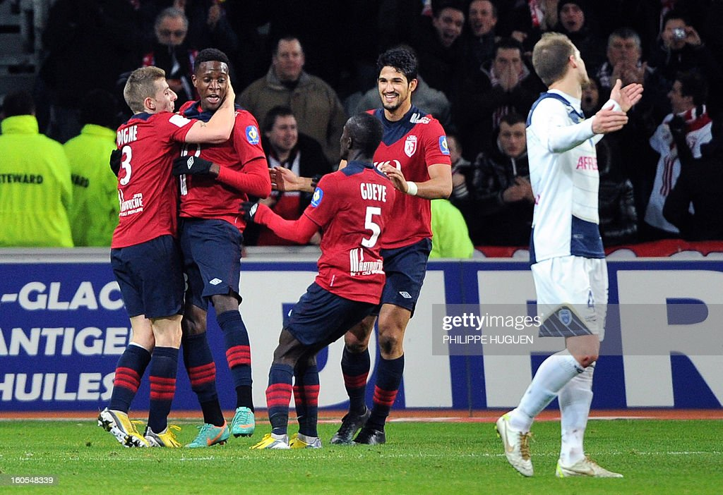 Lille's forward Divock Origi (L) is congratuled by teammate after scoring a goal during the French L1 football match Lille vs Troyes, on February 2, 2013 at the Grand Stade in Villeneuve-d'Ascq.