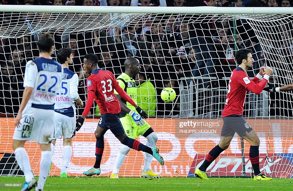 Lille's forward Divock Origi (C) scores a goal during the French L1 football match Lille vs Troyes, on February 2, 2013 at the Grand Stade in Villeneuve-d'Ascq.