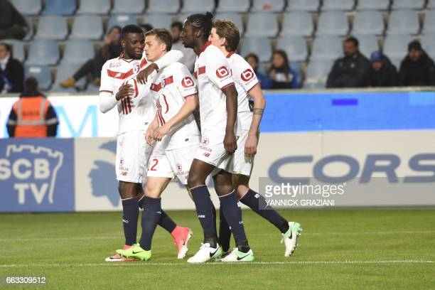 Lille's forward Nicolas De Preville celebrates with his teammates after scoring during the L1 football match Bastia against Lille on April 1 at the...