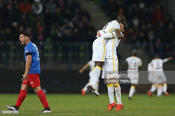 Lille's French defender Adama Soumaoro celebrates with Lille's French forward Alexis Araujo as Caen's French forward Andy Delort reacts after Lille...
