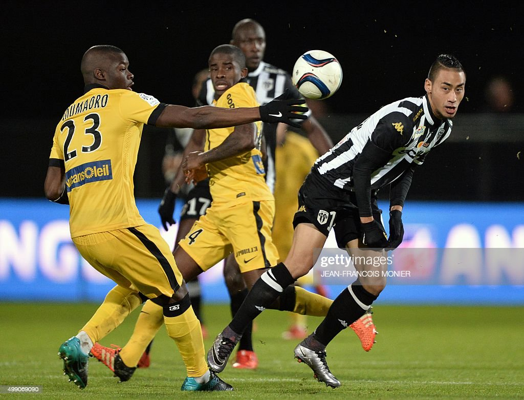 Lille's French defender Adama Soumaoro vies for the ball with Angers' French forward Billy Ketkeophomphon during the French L1 football match between...