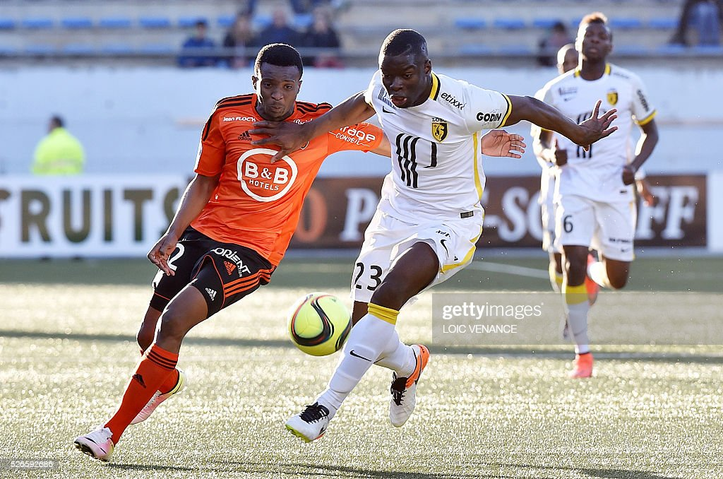 Lille's French defender Adama Soumaoro (R) vies with Lorient's Cameroonian forward Benjamin Moukandjo during the French L1 football match Lorient vs Lyon at the Moustoir stadium in Lorient, western France, on April 30, 2016.