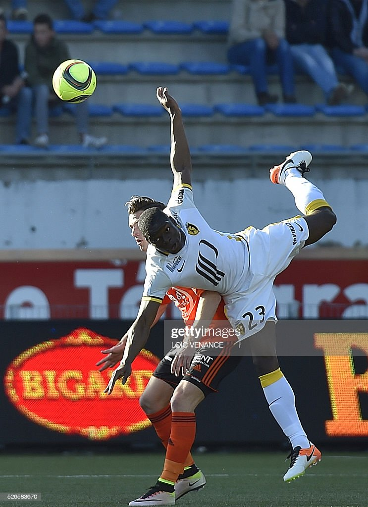 Lille's French defender Adama Soumaoro (R) vies with Lorient's French forward Benjamin Jeannot during the French L1 football match Lorient vs Lyon at the Moustoir stadium in Lorient, western France, on April 30, 2016.