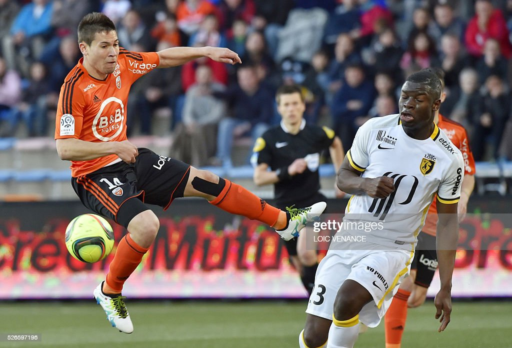 Lille's French defender Adama Soumaoro (R) vies with Lorient's French defender Raphael Guerreiro during the French L1 football match Lorient vs Lille at the Moustoir stadium in Lorient, western France, on April 30, 2016.