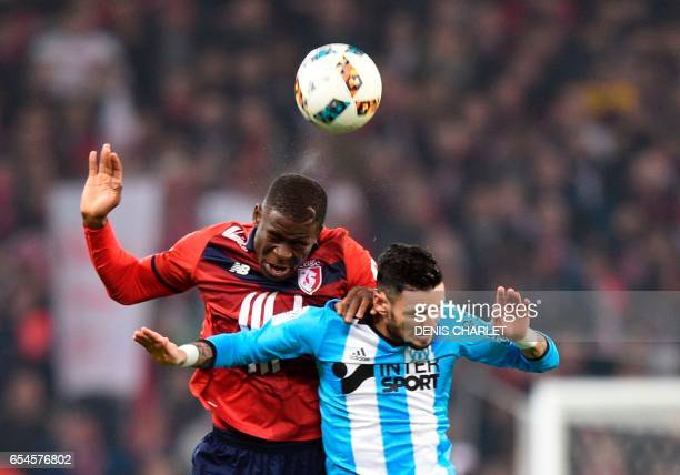 Lille's French defender Adama Soumaoro vies with Olympique de Marseille's French midfielder Remy Cabella during the French L1 football match between...