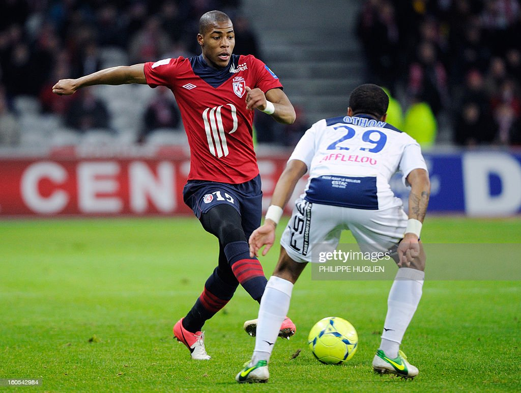 Lille's French defender Dijbril Sidibe (L) vies with Troyes' French midfielder Quentin Othon during a French L1 football match between Lille and Troyes on February 2, 2013 at Grand Stade in Villeneuve d'Ascq.