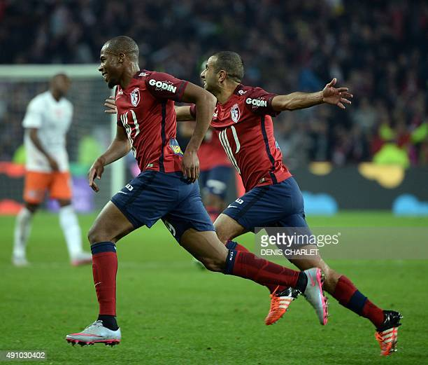 Lille's French defender Djibril Sidibe celebrates with Lille's Moroccan midfielder Mounir Obbadi during the French L1 football match between Lille...