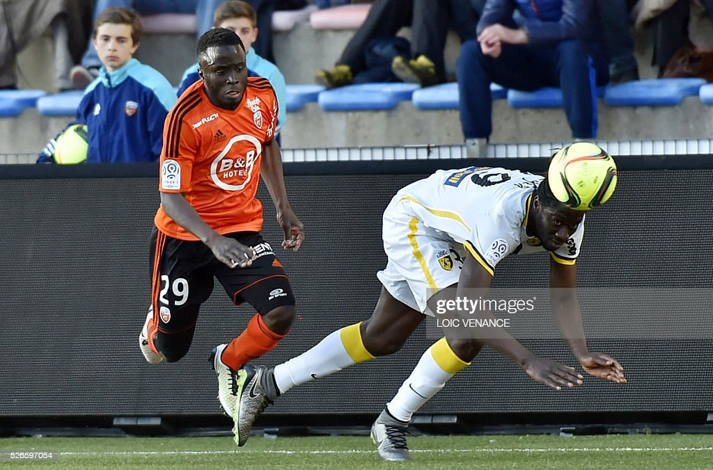 Lille's French defender Djibril Sidibe (R) vies with Lorient's French defender Pape Abdou Paye during the French L1 football match Lorient vs Lyon at the Moustoir stadium in Lorient, western France, on April 30, 2016.
