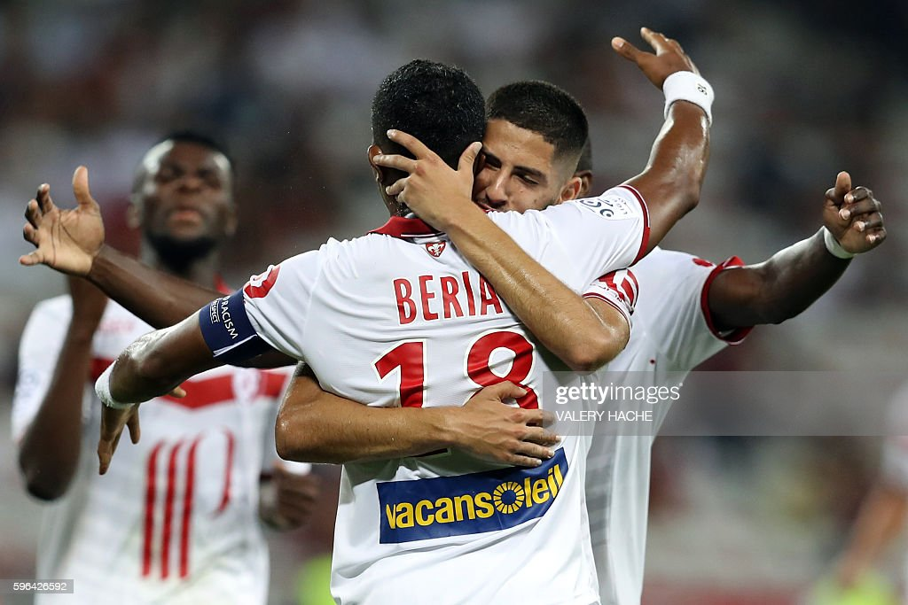 Lille's French defender Franck Beria celebrates with his teammates after scoring a goal during the French L1 football match between Nice and Lille on...