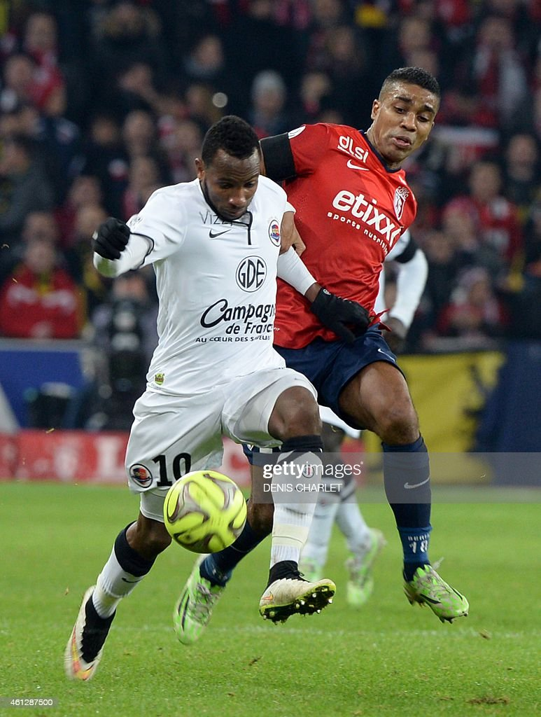 Lille's French defender Franck Beria (R) vies for hthe ball with Caen's French forward Lenny Nangis during the French L1 football match between Lille and Caen in Villeneuve-d'Ascq, northern France, on January 10, 2015. AFP PHOTO / DENIS CHARLET
