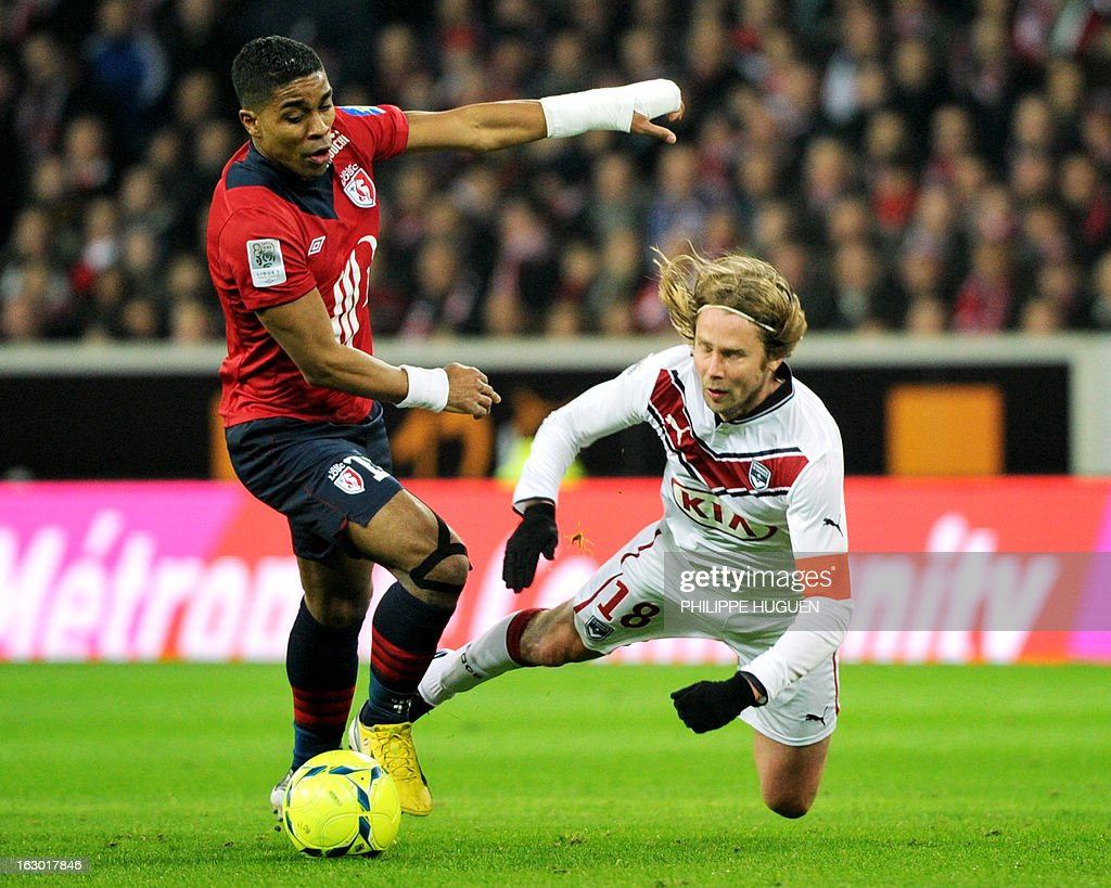 Lille's French defender Franck Beria (L) vies for the ball with Bordeaux's Czech midfielder Jaroslav Plasil during the French L1 football match Lille vs Bordeaux on March 3, 2013 at the Grand Stadium in Villeneuve d'Ascq.