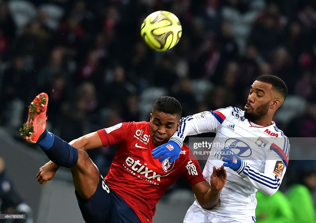 Lille's French defender Franck Beria (L) vies for the ball with Lyon's French forward <a gi-track='captionPersonalityLinkClicked' href=/galleries/search?phrase=Alexandre+Lacazette&family=editorial&specificpeople=6927653 ng-click='$event.stopPropagation()'>Alexandre Lacazette</a> during the French L1 football match between Lille (LOSC) and Lyon (OL) on February 28, 2015 at the Pierre Mauroy Stadium in Villeneuve d'Ascq, northern France. AFP PHOTO / PHILIPPE HUGUEN