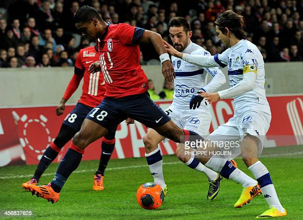 Lille's French defender Franck Beria vies with Bastia's Algerian defender Fethi Harek during the French L1 football match Lille vs Bastia on December...