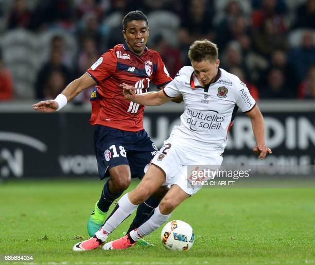 Lille's French defender Franck Beria vies with Nice's French defender Arnaud Souquet during the French L1 football match between Lille and Nice at...