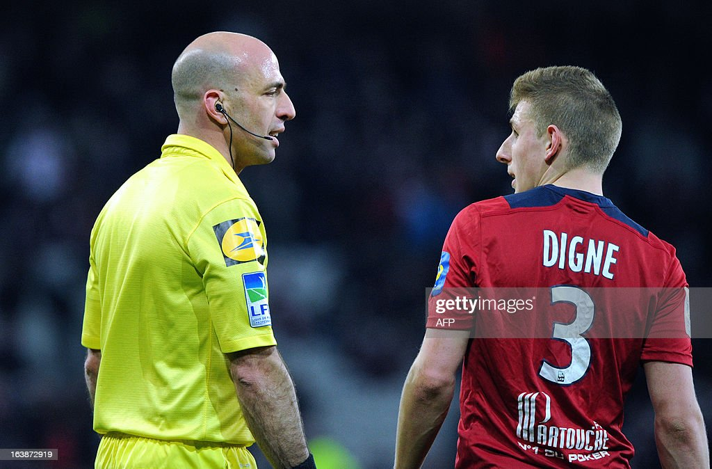 Lille's French defender Lucas Digne (R) argues with French referee Bartolomeu Varela (L) during the French L1 football match Lille vs Evian Thonon Gaillard (ETGFC), on March 16, 2013 at the 'Grand Stade' Stadium in Villeneuve d'Ascq.