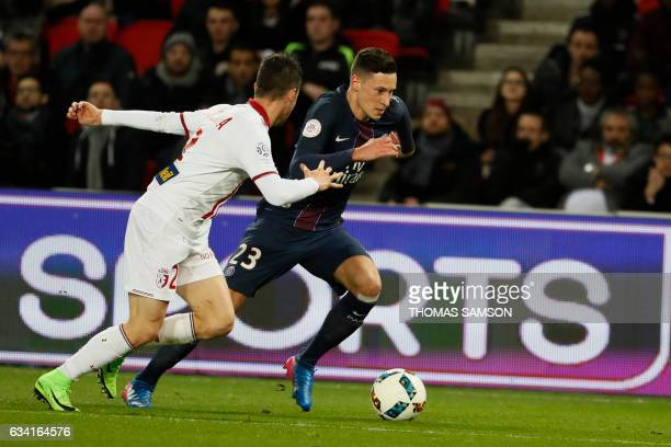 Lille's French defender Sebastien Corchia and Paris SaintGermain's forward Julian Draxler vie for the ball during the French L1 football match...
