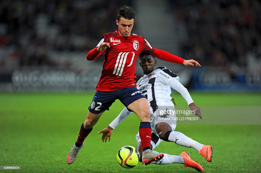 TOPSHOT Lille's French defender Sebastien Corchia vies for the ball with Rennes' French forward Ousmane Dembele during the French L1 football match...
