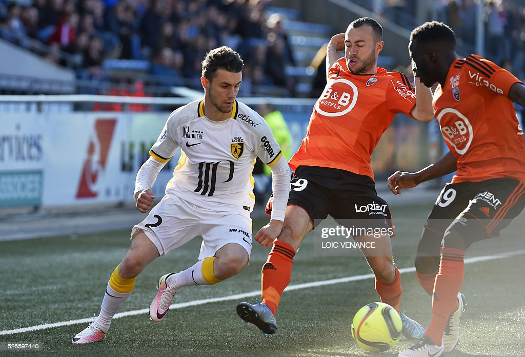 Lille's French defender Sebastien Corchia (L) vies with Lorient's French midfielder Romain Philippoteaux (C) and Lorient's French defender Pape Abdou Paye (R) during the French L1 football match Lorient vs Lille at the Moustoir stadium in Lorient, western France, on April 30, 2016.