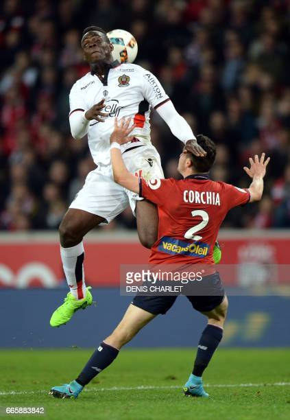 Lille's French defender Sebastien Corchia vies with Nice's Italian forward Mario Balotelli during the French L1 football match between Lille and Nice...