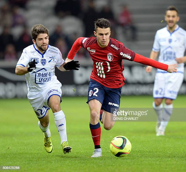 Lille's French defender Sebastien Corchia vies with Troyes's French forward Jimmy Cabot during the French L1 football match between Lille and Troyes...