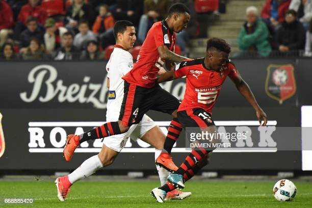 Lille's French forward Anwar El Ghazi Rennes' Mozambican defender Edson Mexer and Rennes' French defender Dimitri Cavare fight for the ball during...