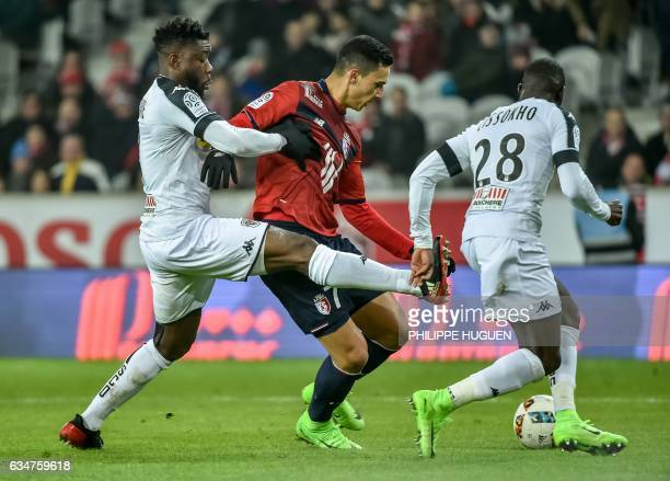 Lille's French forward Anwar El Ghazi vies with Angers' Ivorian defender Ismael Traore during their French L1 football match Lille vs Angers on...