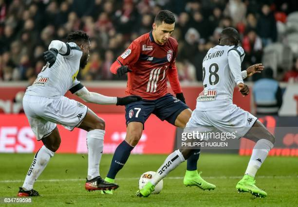 Lille's French forward Anwar El Ghazi vies with Angers' Moroccan midfielder Romain Saiss during their French L1 football match Lille vs Angers on...