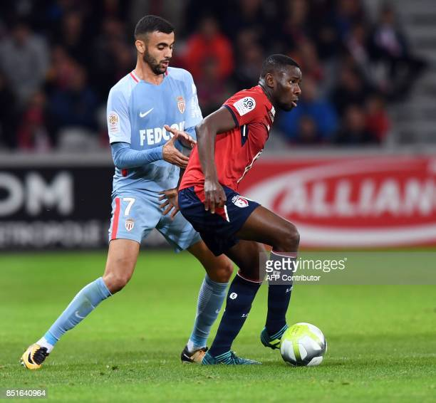 Lille's French forward Anwar El Ghazi vies with Monaco's Brazilian defender Jorge during the French L1 football match between Lille OSC and Monaco on...