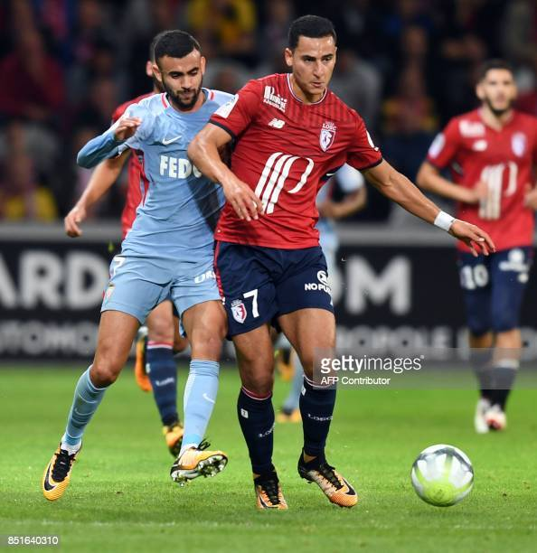 Lille's French forward Anwar El Ghazi vies with Monaco's midfielder Rachid Ghezzal during the French L1 football match between Lille OSC and Monaco...