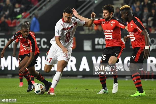 Lille's French forward Anwar El Ghazi vies with Rennes' French midfielder Sanjin Prcic during the French L1 football match Rennes vs Lille on April...