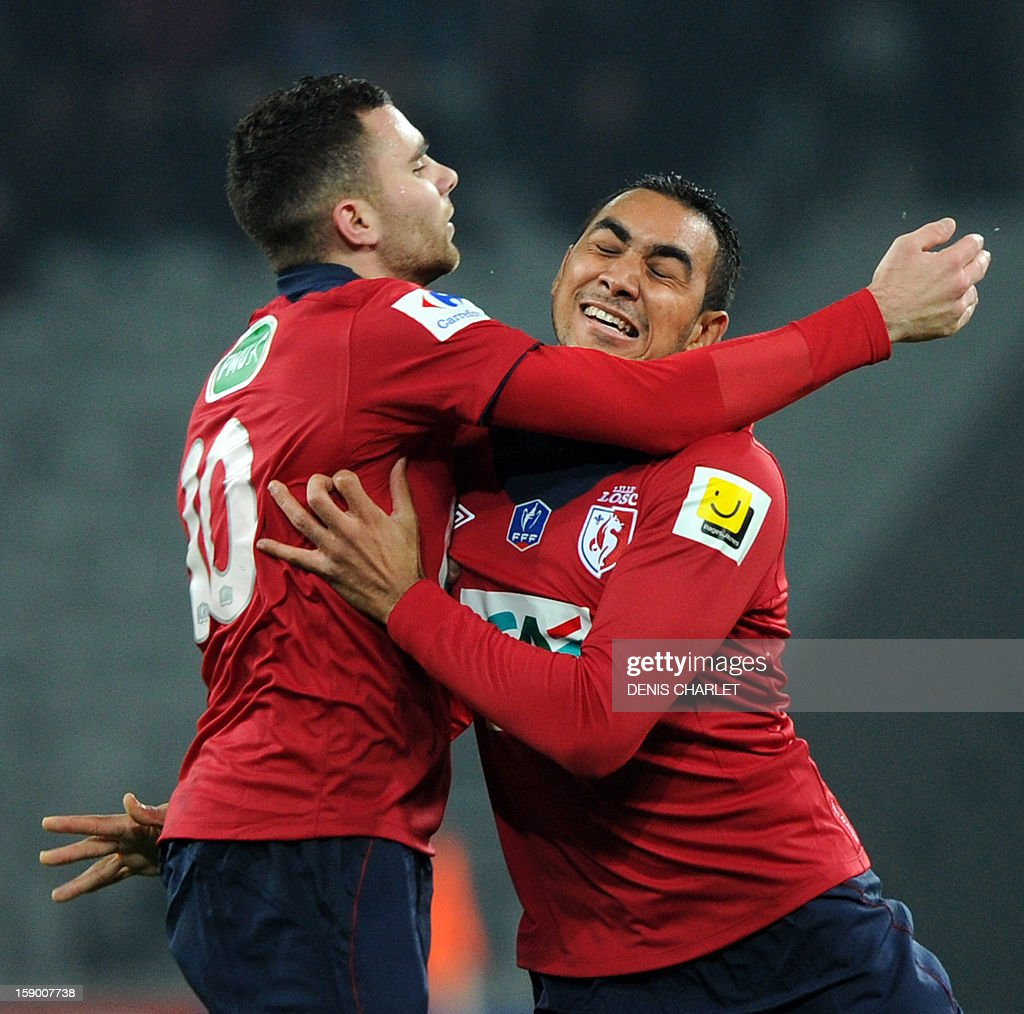 Lille's French forward Dimitri Payet (R) is congratulated by Lille's French midfielder Marvin Martin after scoring a goal during their French Cup football match between Lille and Nimes at the Grand Stade stadium, on January 5, 2013, in Lille. AFP PHOTO /DENIS CHARLET