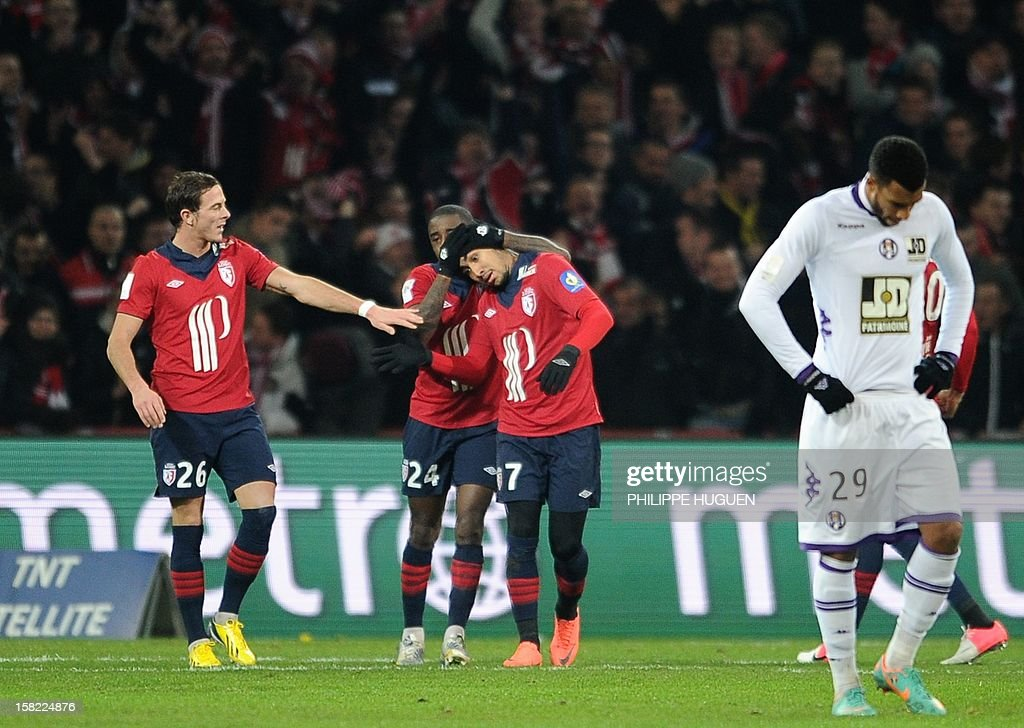 Lille's French forward Dimitri Payet (C) is congratuled by teammates after scoring a goal during the French L1 football match Lille vs Toulouse on December 11, 2012 at the Grand Stade Stadium in Villeneuve d'Ascq, near Lille. AFP PHOTO / PHILIPPE HUGUEN