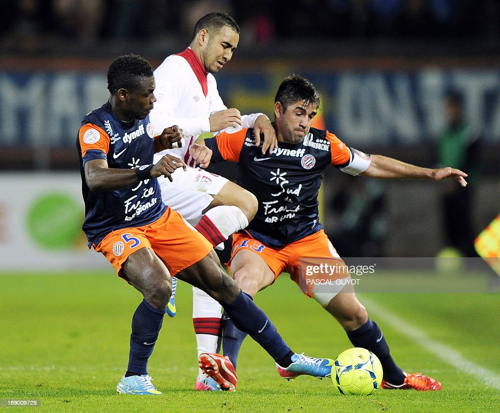 Lille's French forward Dimitri Payet (C) vies for the ball with Montpellier's Cameroonian defender Henri Bedimo (L) and Montpellier's Chilean midfielder Marco Estrada (R) during the French L1 football match Montpellier vs Lille on May 18, 2013 at the Mosson stadium in Montpellier, southern France.